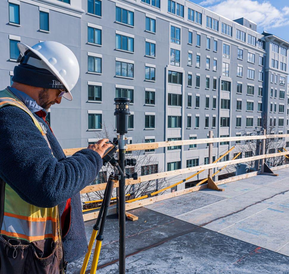Surveyor using total station