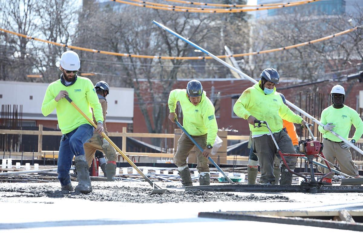 Turner Brothers employees smoothing fresh concrete