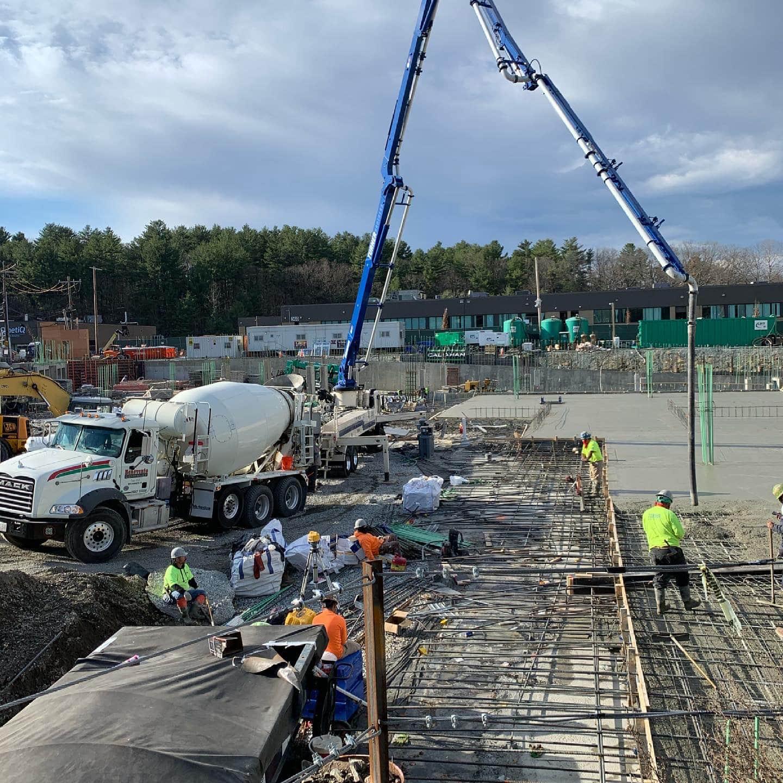 Aerial view of concrete pump pouring a slab of concrete