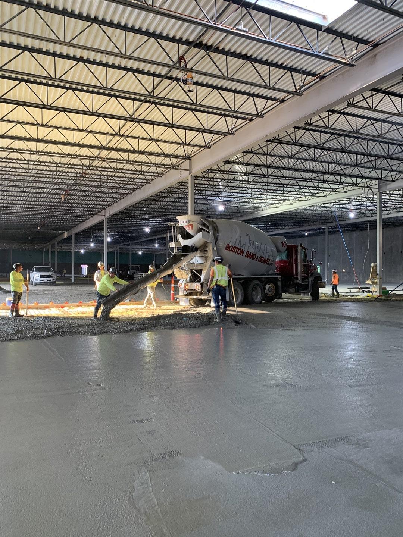 Concrete floor installation in progress